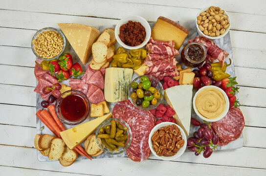 Summer Charcuterie! A spread of antipasti, charcuterie, cheeses and fresh produce.