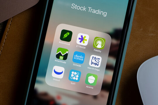 Portland, OR, USA - Jan 28, 2021: Assorted stock trading apps are seen on an iPhone - Robinhood, E-trade, Fidelity, TD Ameritrade, Schwab, Merrill Edge, Webull, SoFi, and Acorns.