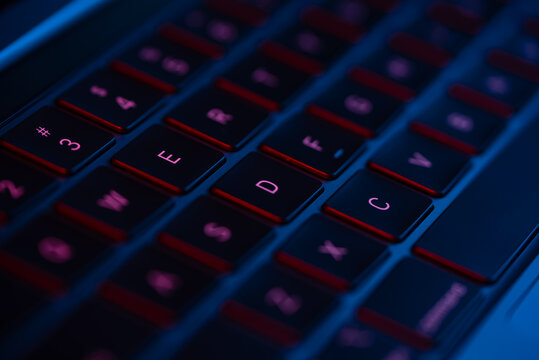 laptop keyboard neon blue and red light