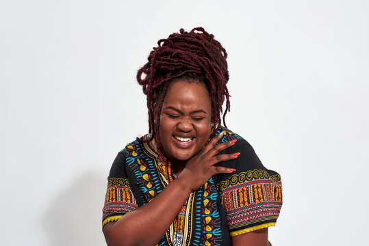 Portrait of plump young haitian woman laughing out loud