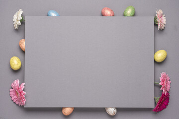 Decorative Easter eggs and spring flowers. Two-layer gray background