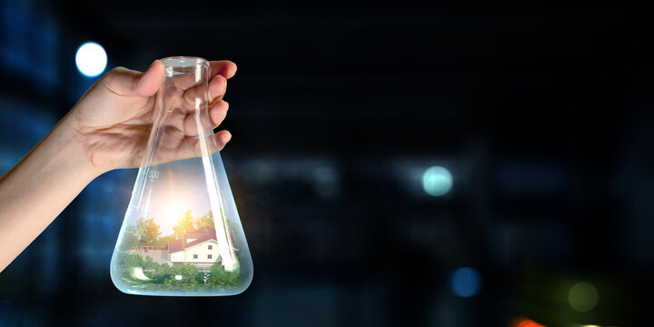 House and grass inside a glass bottle