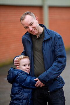 Tom Hayes and his son Josh pose for a picture, in Arundel