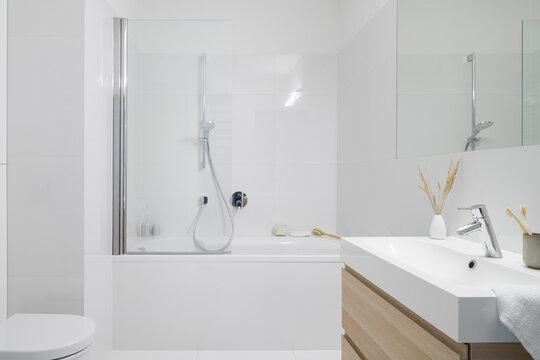 Stylish bathroom with bathtub and shower