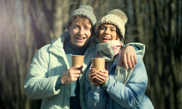 Smiling couple love. Coffee cups. Couple in love. Happy day. Life. Sensual.