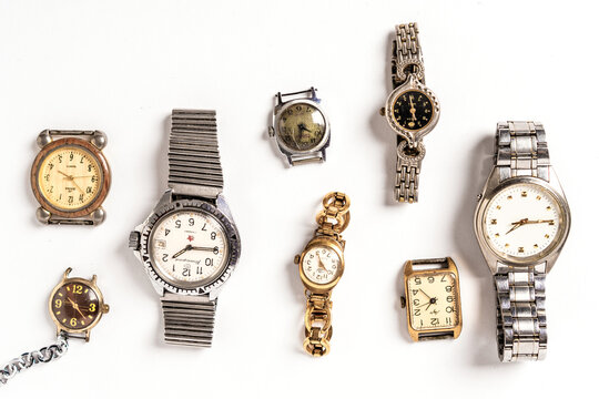 Pattern of different old wristwatches on white background