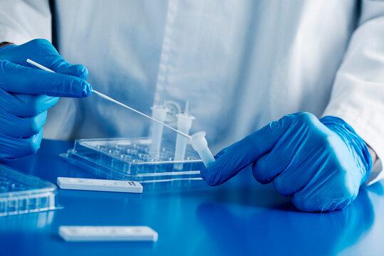 healthcare worker using a covid-19 antigen test