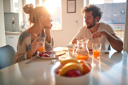 A young couple in love having romantic moments while having a breakfast at home. Relationship, love, together, breakfast