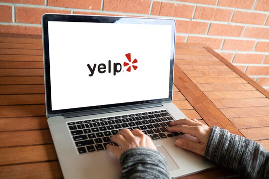Yelp logo editorial illustrative
