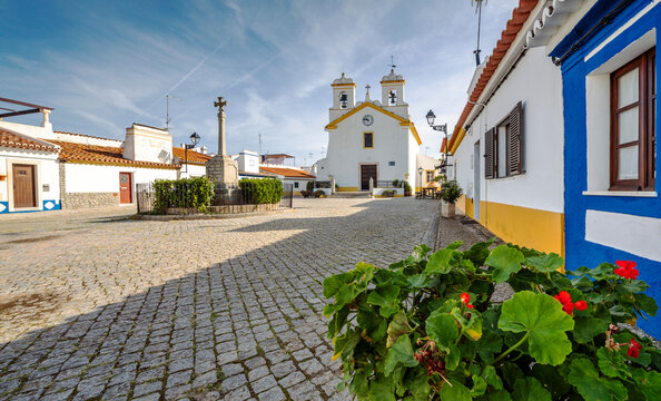 Small square with a church in traditional village, Vila Fernando, Alentejo, Portugal