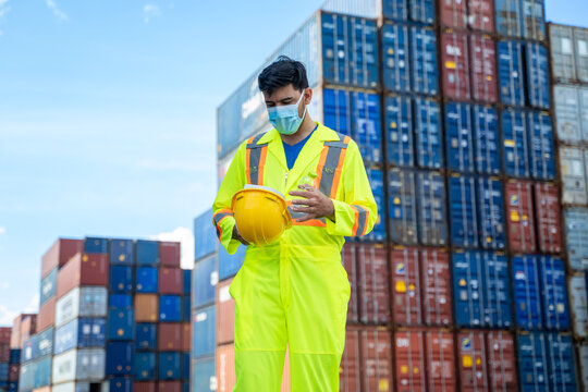 Man worker wearing protective face mask during coronavirus are w