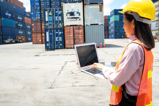 Contenner woman worker with laptop checking position loading con