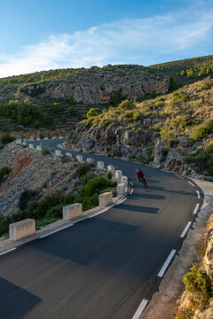 Man riding a bicycle on the mountain road from Benissa to Pinos.