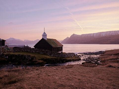 Church in Funningur at sunsrise in the Faroe Islands