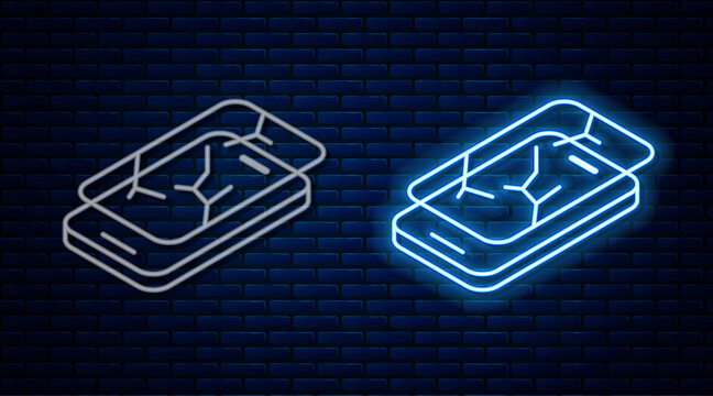 Glowing neon line Smartphone with broken screen icon isolated on brick wall background. Shattered phone screen icon. Vector.