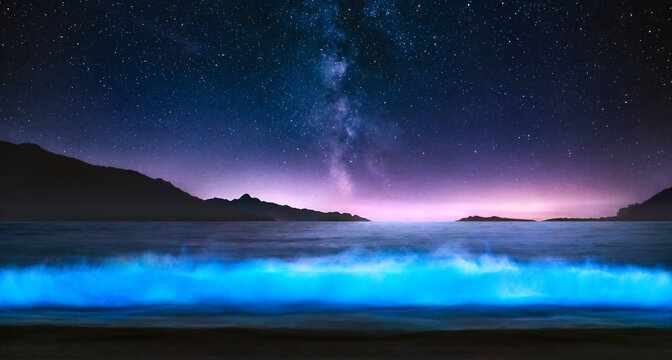 Bioluminescent wave with Milky Way