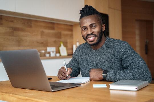 Portrait of happy smiling nice looking African American man wearing headset.
