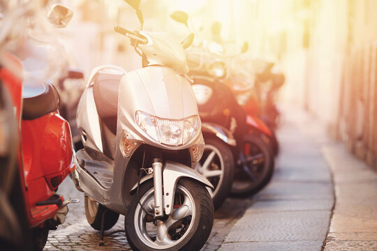 Set of motorbikes for rent parked on street, parking for sharing