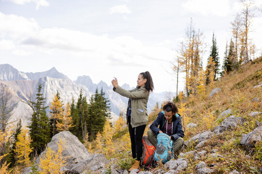 Mother and daughter hiking in scenic majestic Rocky Mountains, Canada