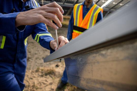Close up of technician fixing solar panel