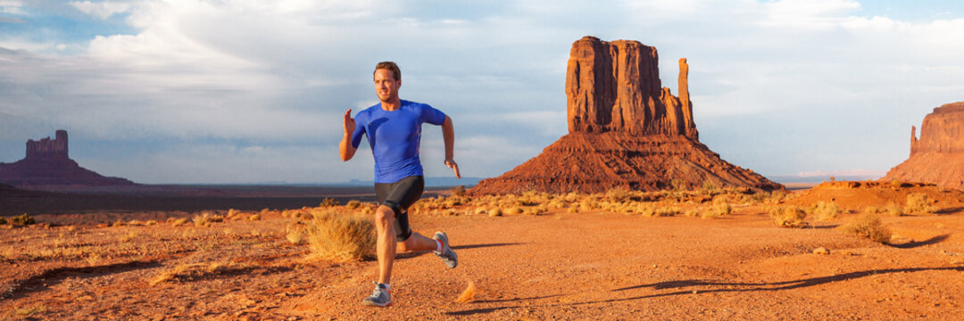 Ultra running trail athlete runner man training long distance endurance doing sprinting exercise desert in mountain landscape on outdoor run. Monument valley, USA banner panoramic. Sport lifestyle.