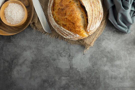 Sourdough rustic bread. Traditional homemade bread, top view, copy space.