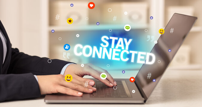 Freelance woman using laptop with STAY CONNECTED inscription, Social media concept