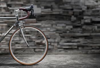Vintage style road bike on old concrete floor.