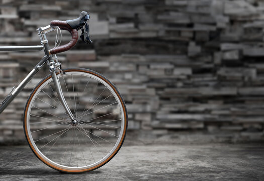 Vintage style road bike on old concrete floor.