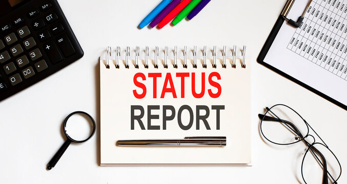 Notebook with Tools and Notes about Status Report business concept