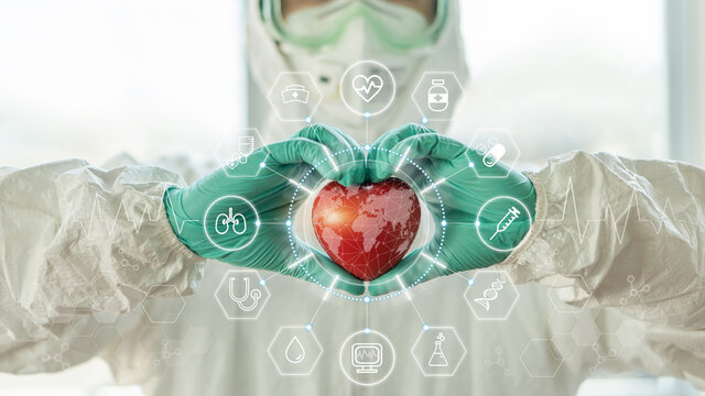 Medical technology, global health tech and world heart health day concept with cardiologist doctor in ppe for covid-19 protection in hospital cardiac cath lab for coronary laboratory science research
