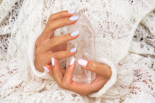 Woman's hands holding the natural protection crystal.