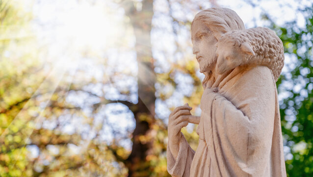 Profile image of antique statue of Jesus Christ Good Shepherd. In the Christian tradition, a symbol of human importance to God.