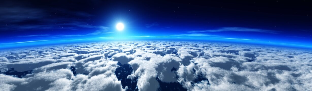 Flying over the clouds, clouds from a low orbit, the sun rises over the clouds