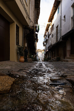 Photo of an empty street of an ancient village in the region of Gata, north of Extremadura, Spain. The villages in this area have the scoring on the surface so you can see it easily