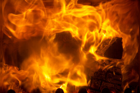 Flames of fire in a fireplace.Abstract background.