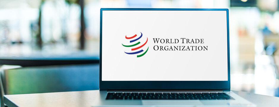 Laptop computer displaying logo of World Trade Organization