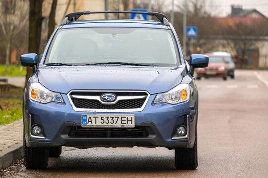 Kyiv, Ukraine - October 14, 2020: Blue Subaru Crosstrek XV car parked on a city street side.