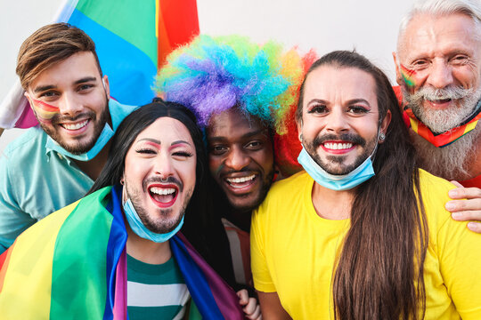 Portrait of multiracial gay people having fun at lgbt pride parade - Focus on front faces