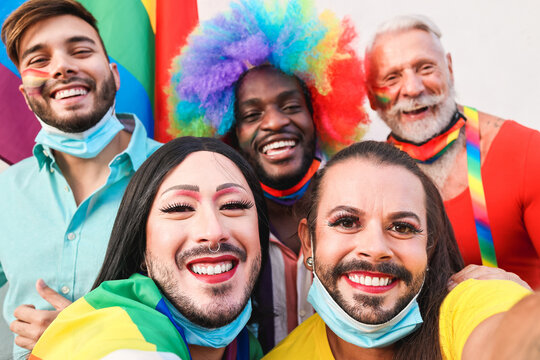 Group of friends taking a selfie at LGBT parade during coronavirus outbreak - Focus on transgender