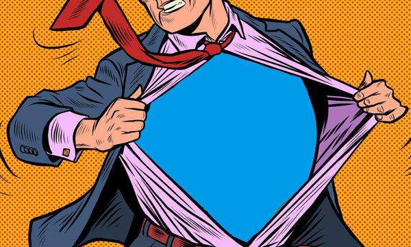 Superhero businessman tearing the suit