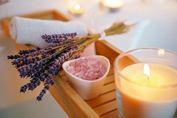 Obraz Spiritual aura cleansing ritual bath for full moon ritual. Candles, aroma salt and lavender on tub table, close up - fototapety do salonu