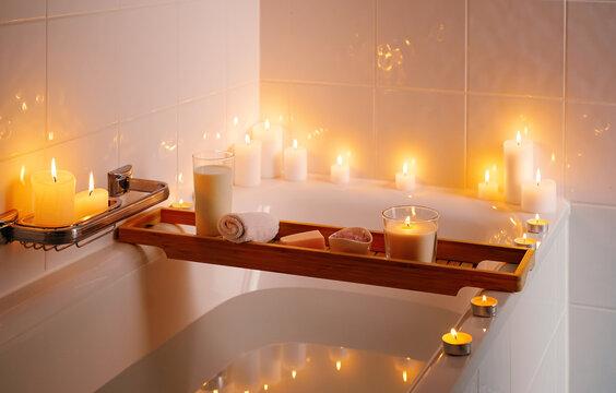 Spiritual aura cleansing ritual bath for full moon ritual with candles, aroma salt and milk.