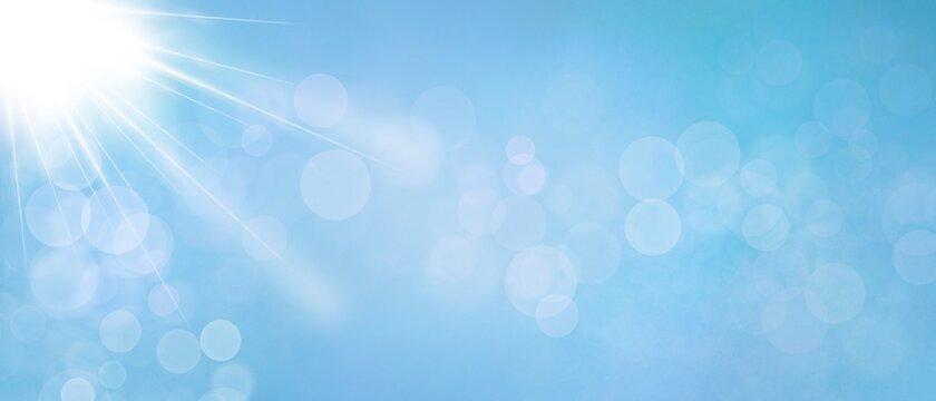 Web banner sfondo azzurro con luce magica e bokeh