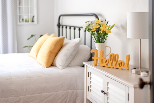 Cheerful hello sign in clean and bright bedroom
