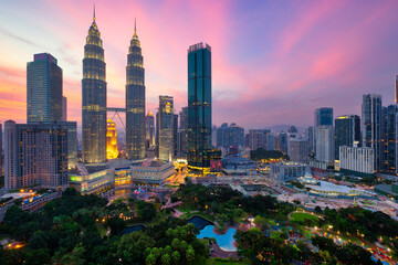 Kuala Lumpur skyline financial downtown district and KLCC park view at sunset