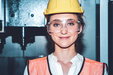 Young woman factory worker close up portrait in manufacturing job factory . Industry and...