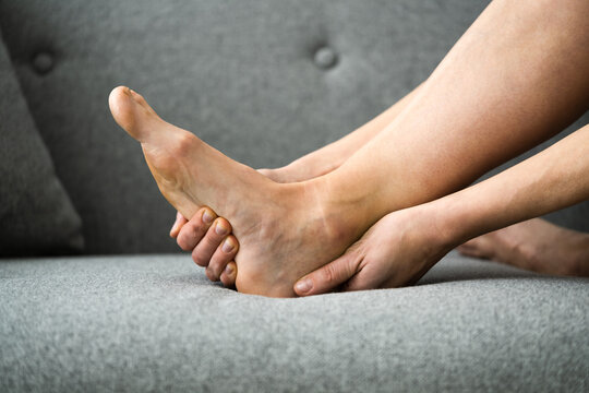 Woman Feeling Achilles Heel Pain