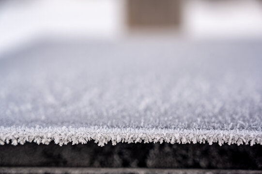 Subjective focus on crystalized frost on the edge of a metal box