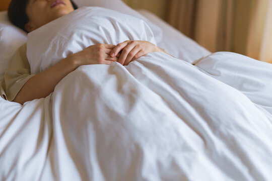 middle aged woman sleeping in the bed